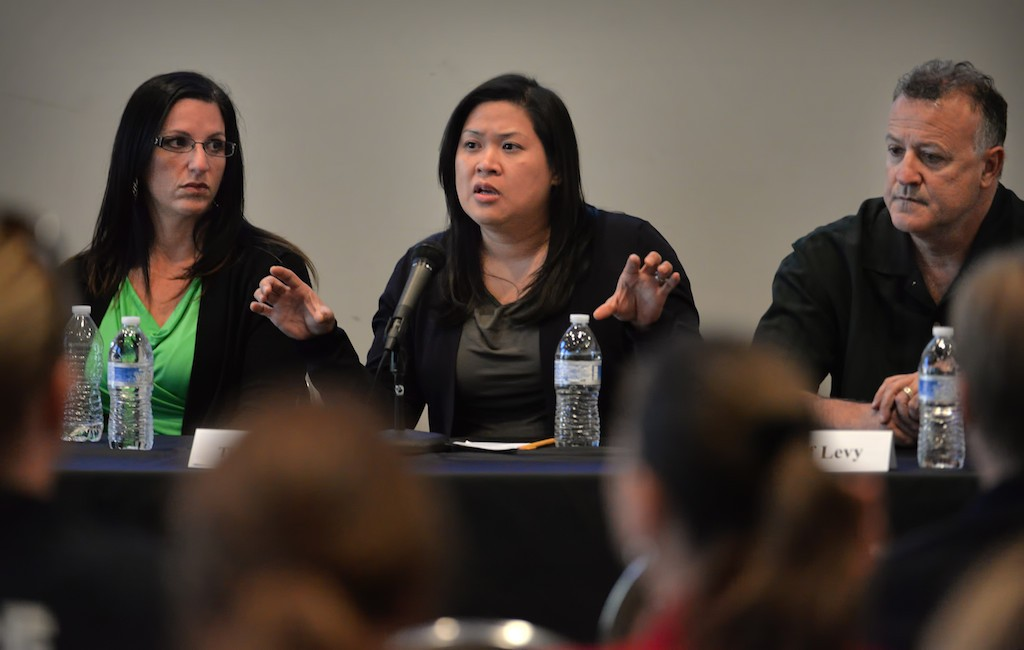 Tina Rocha, Crisis Response Program Specialist, Orange County Department of Education, center, talks on a panel discussion on mental health and how they are handled by law enforcement with Dr. Heather Williams, left, and Josef Levy, right. Photo by Steven Georges/Behind the Badge OC