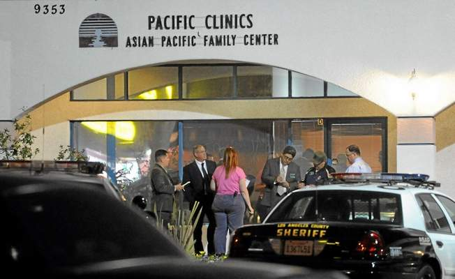 Los Angeles County sheriff's investigators and deputies gather outside the Asian Pacific Family Center on Valley Boulevard, where an officer-involved fatal shooting in Rosemead in January 2012 resulted in the death of a mentally ill woman. The death has prompted new training on dealing with the mentally ill.