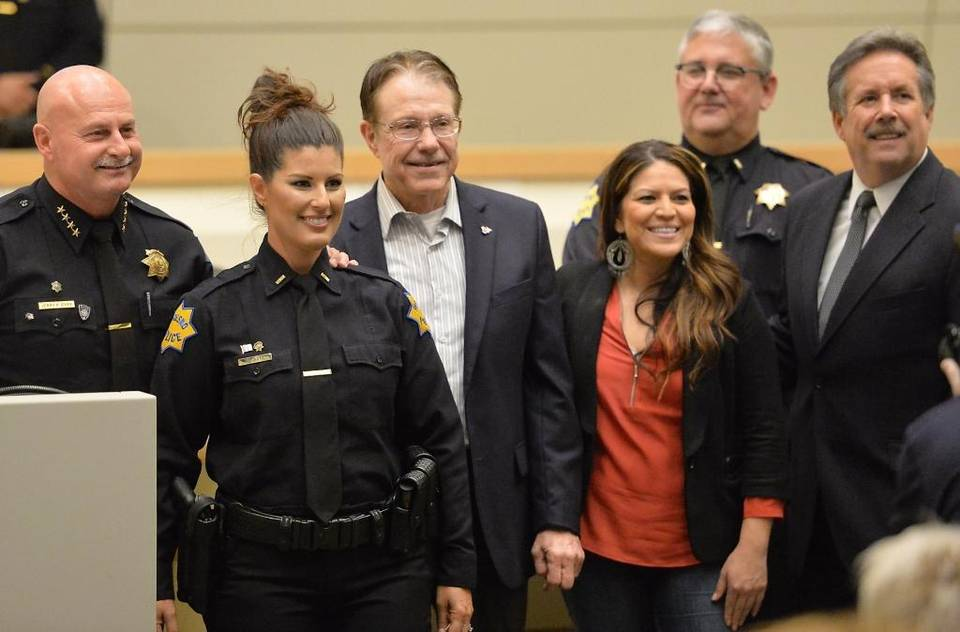 Fresno Police Lieutenant Mindy Casto, second from left, poses for photos with city leaders at a promotions and swearing-in ceremony Oct. 27, 2015, at Fresno City Hall. Forty cadets, recruits, sergeants and lieutenants were sworn in or promoted, but the department still has a long way to go to rebuild its ranks of officers and top staff.